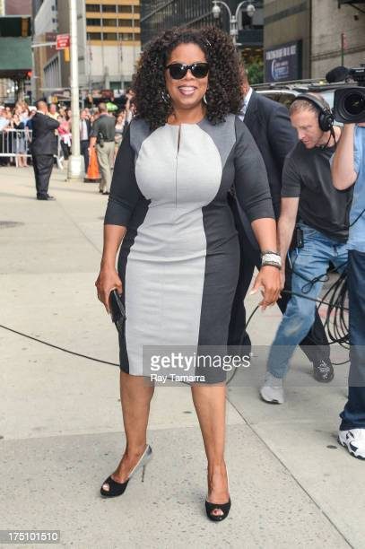 """Actress and producer Oprah Winfrey enters the """"Late Show With David Letterman"""" taping at the Ed Sullivan Theater on July 31, 2013 in New York City."""
