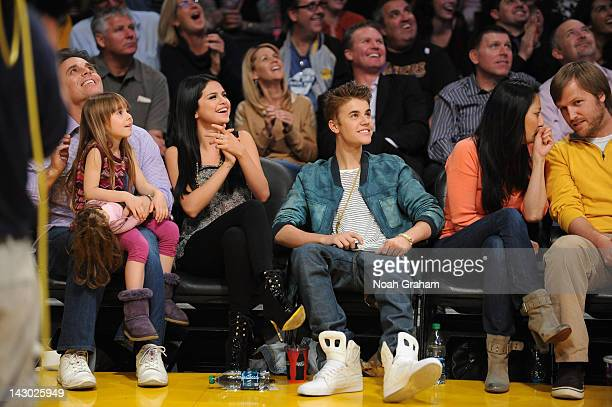 Actress and recording artist Selena Gomez and boyfriend Justin Bieber attend a game between the San Antonio Spurs and the Los Angeles Lakers at...