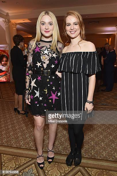 Actress and Save the Children Artist Ambassador Dakota Fanning and singer/songwriter and Save the Children Artist Ambassador Bridgit Mendle attend...