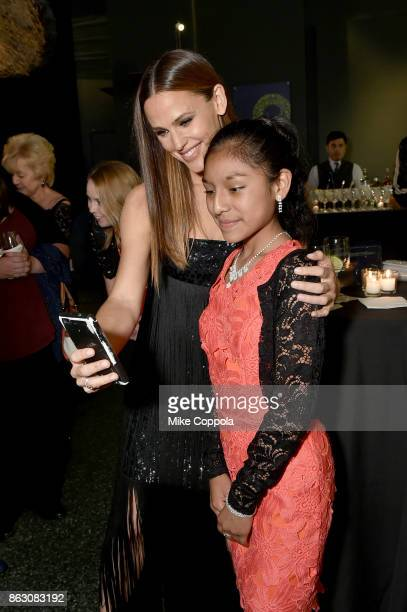 Actress and Save the Children Trustee Jennifer Garner and Save the Children beneficiary Nicole attend the 5th Annual Save the Children Illumination...