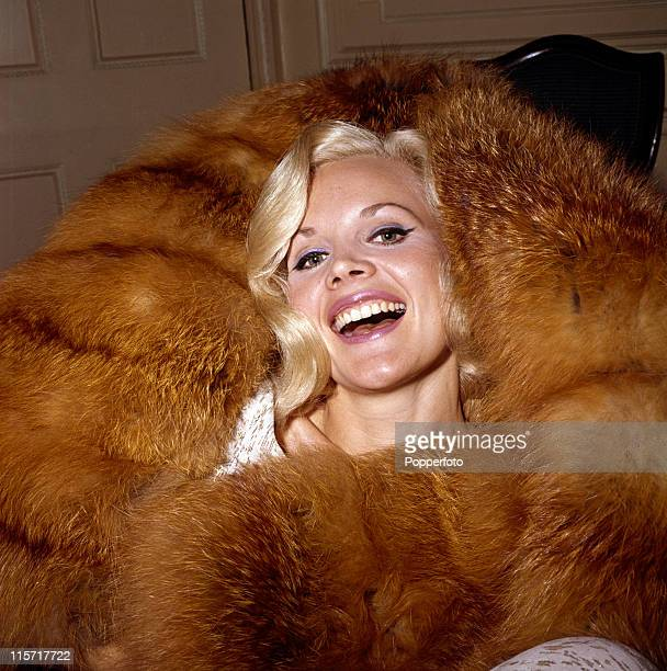 Actress and sex symbol Carroll Baker star of 'Baby Doll' swathed in red fox fur circa 1963