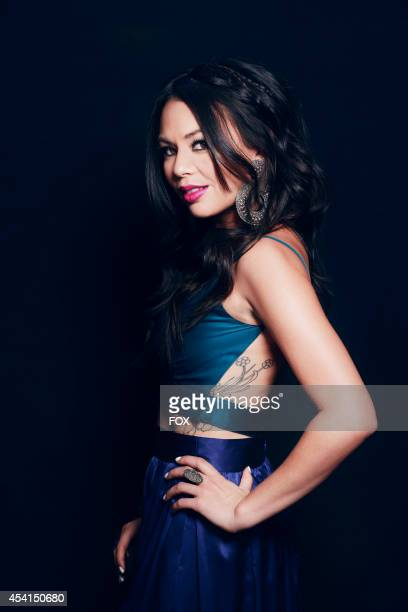 Actress and singer Janel Parrish is photographed at the Fox 2014 Teen Choice Awards at The Shrine Auditorium on August 10, 2014 in Los Angeles,...