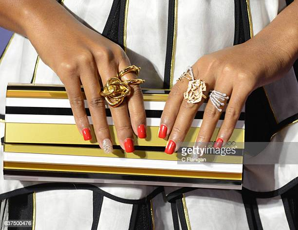 Actress and Singer Janelle Monae Purse and Jewelry Detail attends the 28th Annual Palm Springs International Film Festival Film Awards Gala at Palm...