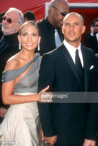 Actress and singer Jennifer Lopez and boyfriend Chris Judd pose for a portrait during The 73rd Annual Academy Awards Arrivals on March 25 2001 at the...
