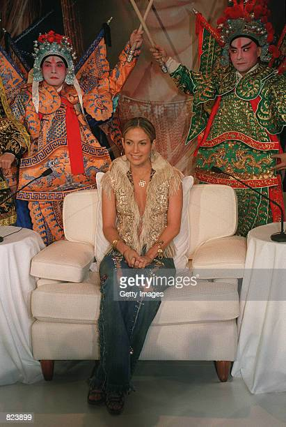 Actress and singer Jennifer Lopez poses with Cantonese opera performers February 19 2001 in Hong Kong during a press conference to promote her latest...