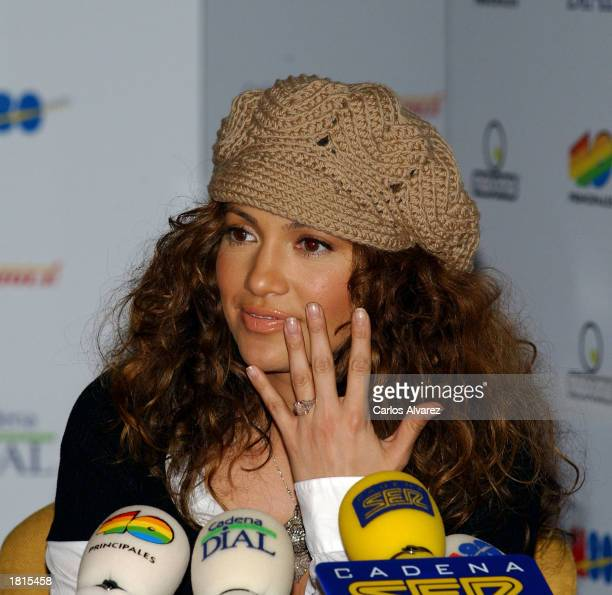 Actress and singer Jennifer Lopez shows her engagement ring during an interview at the Cadena Ser radio station February 25, 2003 in Madrid, Spain.