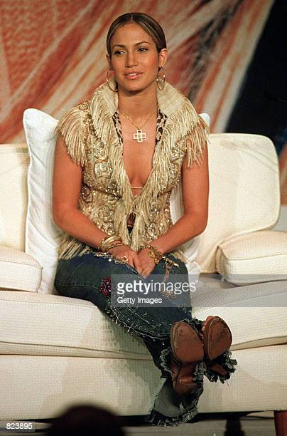 Actress and singer Jennifer Lopez talks with the media February 19 2001 in Hong Kong during a press conference to promote her latest album