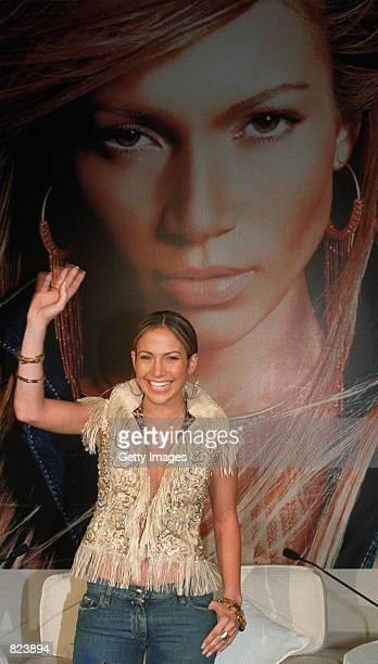 Actress and singer Jennifer Lopez waves during a press conference to promote her latest album February 19 2001 in Hong Kong