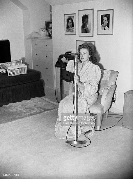 Actress and singer Judy Garland uses a personal recording machine in her MGM dressing room circa 1940 in Los Angeles California