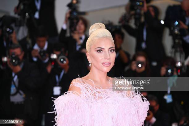 Actress and singer Lady Gaga walks the red carpet ahead of the 'A Star Is Born' screening during the 75th Venice Film Festival at Sala Grande on...