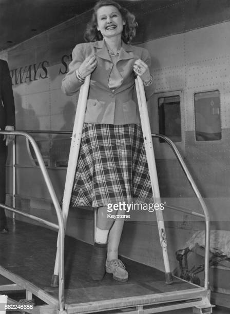 Actress and singer Lilian Harvey disembarks from a clipper in New York on crutches after breaking her leg in a blackout in London World War II circa...