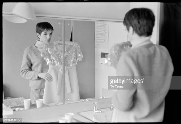 Actress and singer Liza Minnelli looking at a costume backstage before an appearance on musical variety programme the Hippodrome Show, circa 1966.