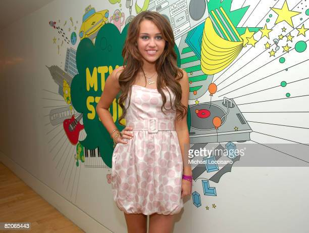 """Actress and singer Miley Cyrus co-hosts MTV's """"TRL"""" at the MTV studios in Times Square on July 18, 2008 in New York City."""