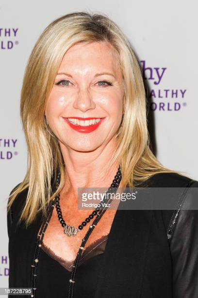 Actress and singer Olivia NewtonJohn arrives at Mom On A Mission's 5th Annual Awards Gala on November 6 2013 in Pacific Palisades California