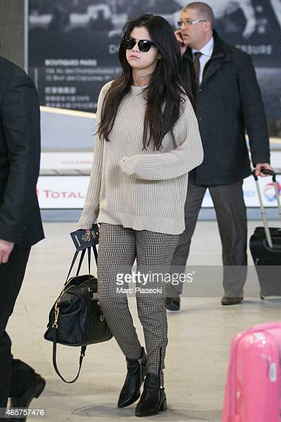 Actress and singer Selena Gomez arrives at CharlesdeGaulle airport during the Paris Fashion Week Fall Winter 2015/2016 on March 10 2015 in Paris...