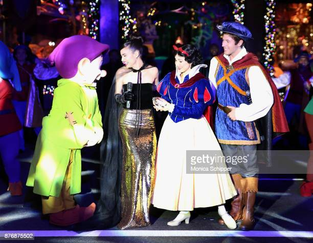Actress and singer Sofia Carson is joined by Snow White The Prince and the Seven Dwarfs when she performs during the 2017 Saks Fifth Avenue Holiday...