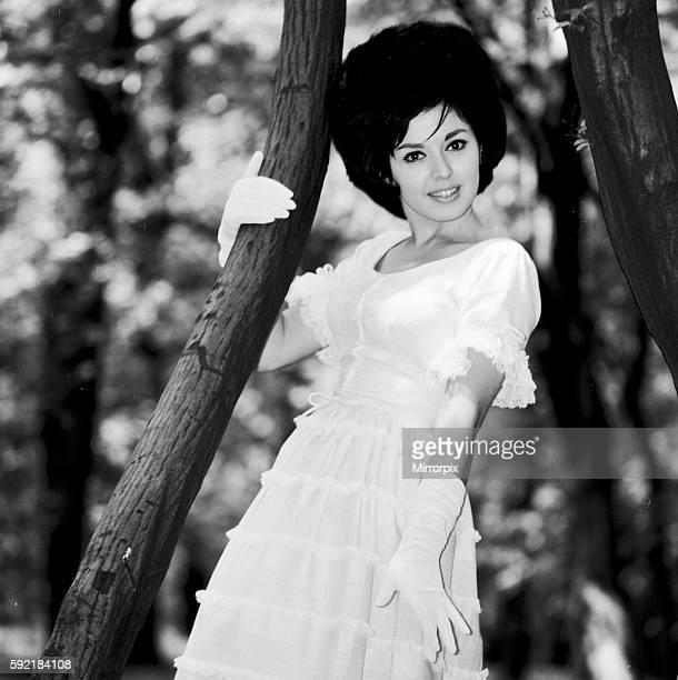 Actress and singer Susan Maughan aged 20 photographed in a park near her home in Hornsey London wearing an Ascot styled hat and dress 11th June 1963