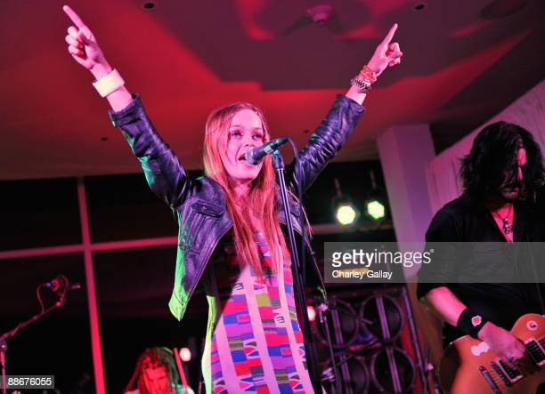 Actress and singer Taryn Manning performs alongside former Guns 'n' Roses guitarist Gilby Clarke at the Jose Cuervo Platino Penthouse with 944...