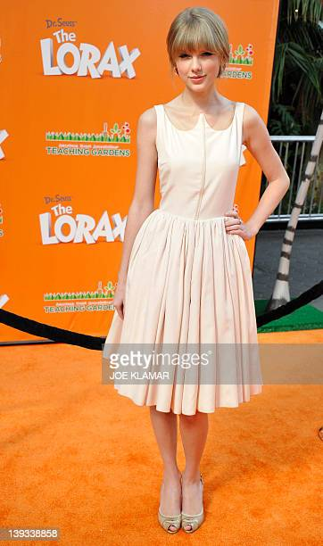 Actress and singer Taylor Swift poses for pictures as she arrives for the premiere of Dr Seuss' The Lorax at Universal Studios Hollywood on February...