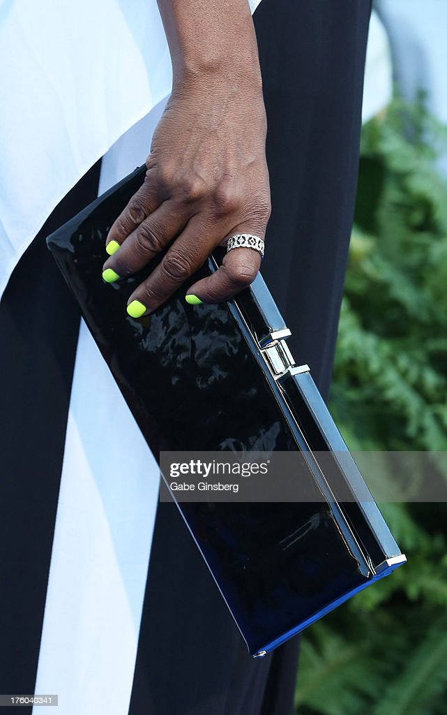 Actress and singer Tichina Arnold (purse detail) arrives at the 11th annual Ford Neighborhood Awards at the MGM Grand Garden Arena on August 10, 2013 in Las Vegas, Nevada.