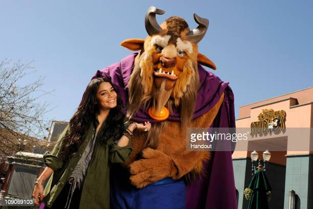 Actress and singer Vanessa Hudgens starring in the upcoming film 'Beastly' poses with Beast of 'Beauty and the Beast' at Disney's Hollywood Studios...