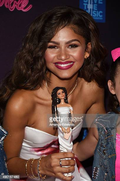 Actress and singer Zendaya poses with a Zendaya Barbie doll at the Barbie Rock 'N Royals Concert Experience at the Hollywood Palladium on September...