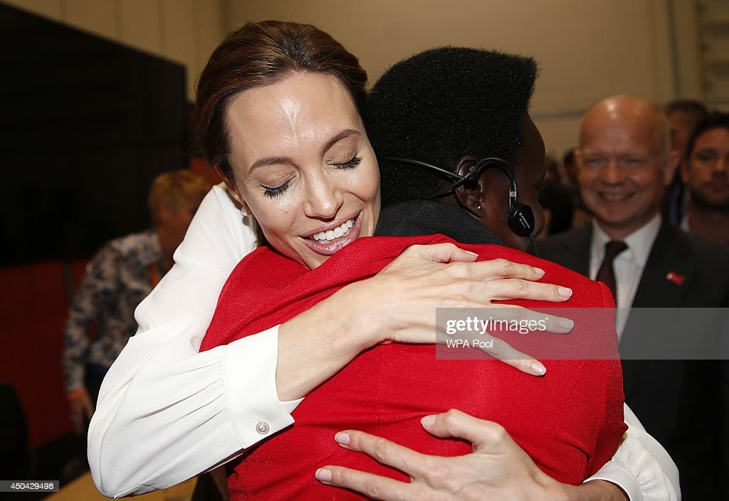 US Actress and Special Envoy of the United Nations High Commissioner for Refugees, Angelina Jolie embraces Esther Ruth Atim of Uganda, at the 'End Sexual Violence in Conflict' summit at ExCel on June 11, 2014 in London, England. The four-day conference on sexual violence in war is hosted by Foreign Secretary William Hague and UN Special Envoy and actress Angelina Jolie.