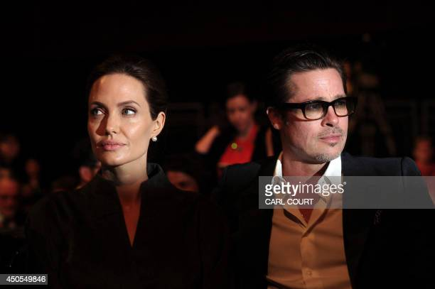US actress and special UN envoy Angelina Jolie and her husband US actor Brad Pitt attend the fourth day of the Global Summit to End Sexual Violence...
