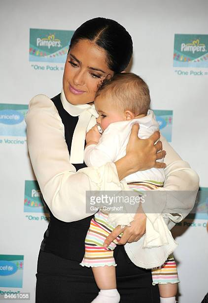 Actress and spokesperson Salma Hayek holding Kaya Haggerty attends the second year launch of the One Pack = One Vaccine campaign at the United States...
