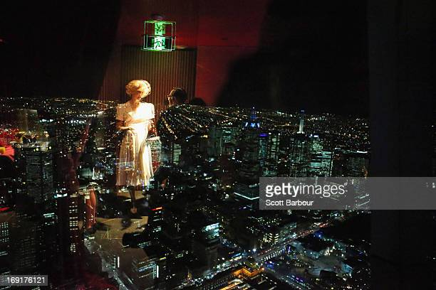 Actress and star of King Kong Esther Hannaford is reflected in a window as she looks over the city of Melbourne during a 'King Kong' production photo...