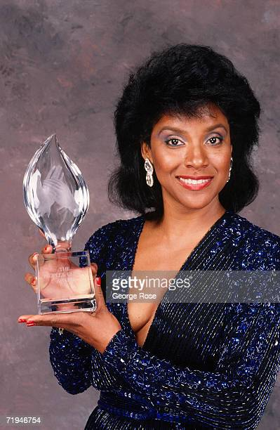 """Actress and star of """"The Cosby Show,"""" Phylicia Rashad, poses with her People's Choice Award in a 1989 backstage Beverly Hills, California telecast..."""