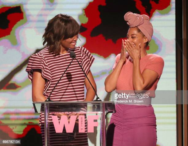 Actress and The Lucy Award for Excellence in Television Honoree Tracee Ellis Ross receives award presented by actress Aisha Tyler onstage at Women In...