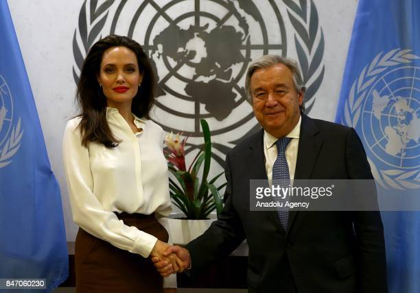 US actress and the UN refugee agency UNHCR Special Envoy Angelina Jolie shakes hands with United Nations Secretary General Antonio Guterres at United...