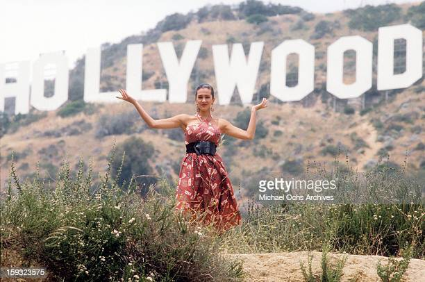 Actress and TV personality Allegra Curtis poses for a portrait under the Hollywood sign in 1988 in Los Angeles California