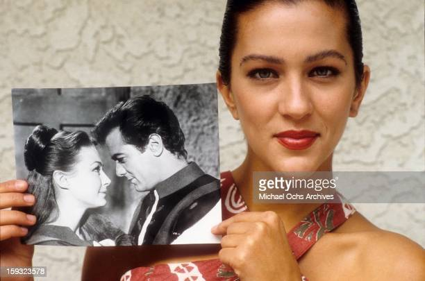 Actress and TV personality Allegra Curtis poses with a photo of her parents Tony Curtis and Christine Kaufmann in 1988 in Los Angeles California