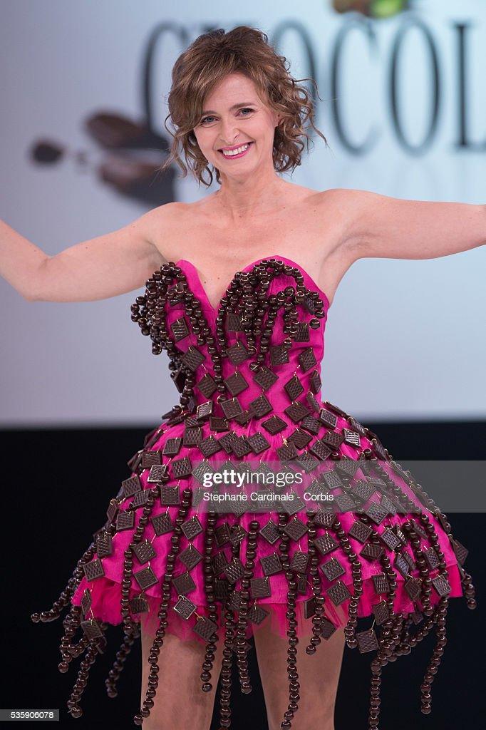 Actress and TV presenter Annabelle Milot walks the runway and wears 'La Deesse Chocolatee' a chocolate dress made by designer Nathalie Vigne and chocolate maker Francois Pralus during the Fashion Chocolate Show at Salon du Chocolat at Porte de Versailles, in Paris.
