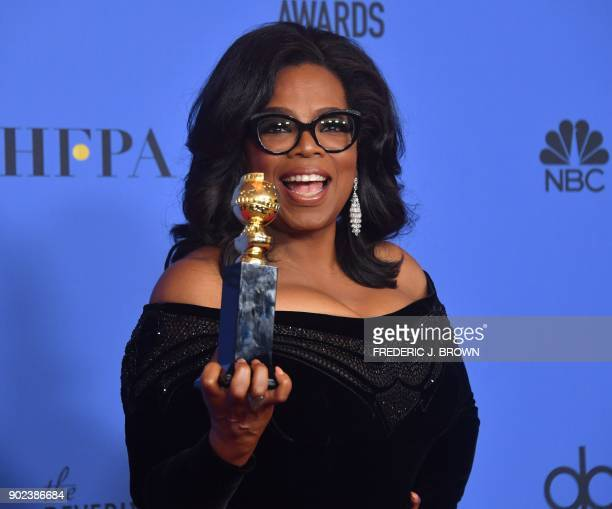 Actress and TV talk show host Oprah Winfrey poses with the Cecil B DeMille Award during the 75th Golden Globe Awards on January 7 in Beverly Hills...