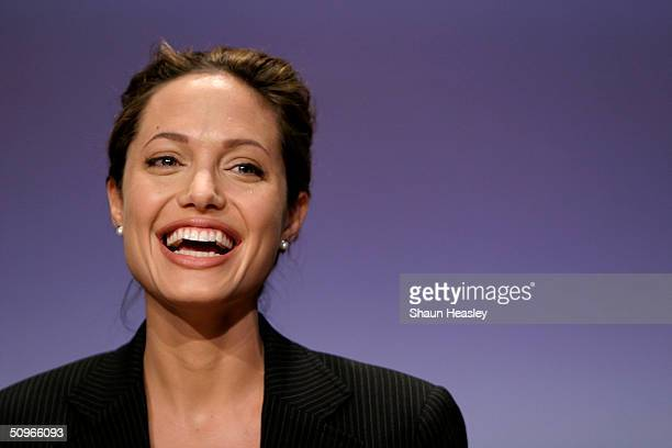 Actress and UN goodwill ambassador Angelina Jolie smiles during the launch of World Refugee Day at Explorers Hall at the National Geographic Museum...