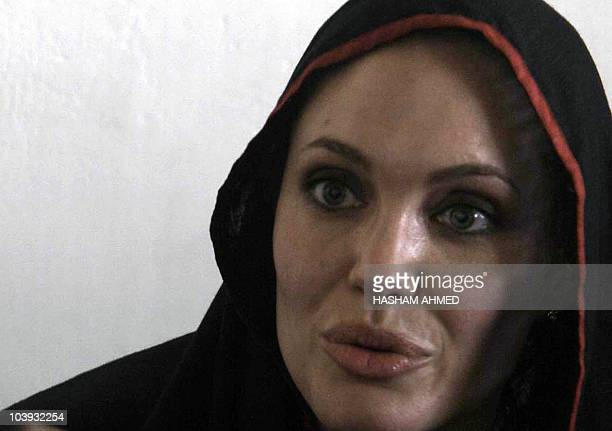 US actress and UNHCR Goodwill Ambassador Angelina Jolie speaks during a press conference in Jalozai Camp after a visit to a makeshift camp for flood...