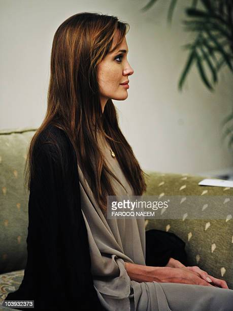 US actress and UNHCR Goodwill Ambassador Angelina Jolie talks with Pakistani Prime Minister Yousaf Raza Gillani during a meeting in Islamabad on...