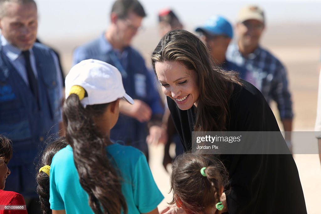 US actress and UNHCR special envoy and Goodwill Ambassador Angelina Jolie greets children during a press conference at Al- Azraq camp for Syrian refugees on September 9, 2016, in Azraq, Jordan. Jolie arrived at the camp and visited syrian families before speaking to the media.