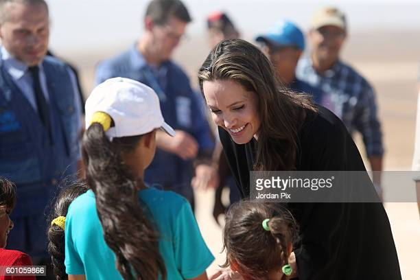 US actress and UNHCR special envoy and Goodwill Ambassador Angelina Jolie greets children during a press conference at Al Azraq camp for Syrian...