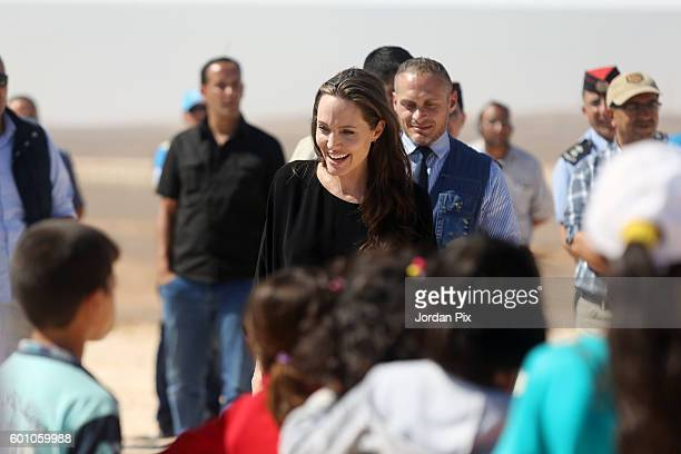 Actress and UNHCR special envoy and Goodwill Ambassador Angelina Jolie greets children during a press conference at Al- Azraq camp for Syrian...