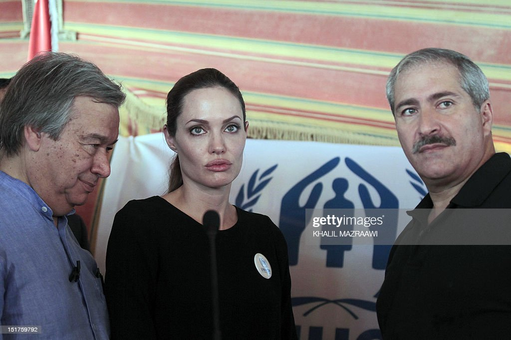 US actress and UNHCR special envoy Angelina Jolie, accompanied by UN High Commissioner for Refugees Antonio Guterres (L) and Jordanian foreign Minister Nasser Judeh (R), briefs the press during her visit to the Zaatari refugee camp near the Jordanian border with Syria, on September 11, 2012. The number of refugees who have fled Syria has reached more than 250,000, the United Nations said , calling the humanitarian problems sparked by the conflict 'our biggest crisis'.