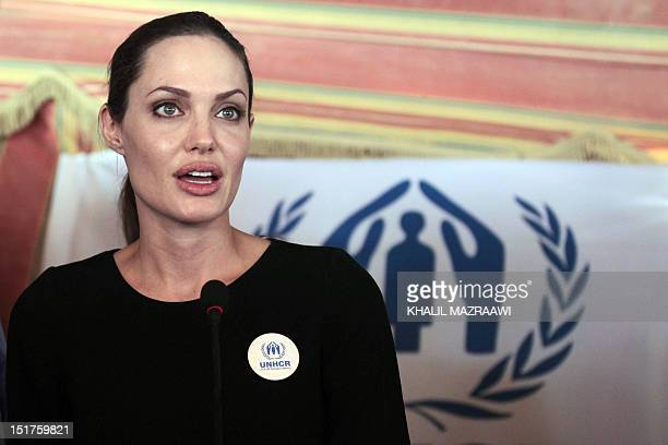 Actress and UNHCR special envoy Angelina Jolie, accompanied by UN High Commissioner for Refugees Antonio Guterres and Jordanian foreign Minister...