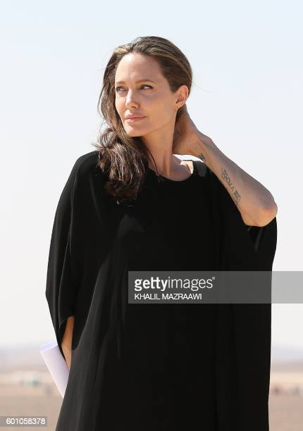 Actress and UNHCR special envoy Angelina Jolie looks on during a visit to a Syrian refugee camp in Azraq in northern Jordan, on September 9, 2016.