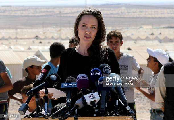 US actress and UNHCR special envoy Angelina Jolie talks during a visit to a Syrian refugee camp in Azraq in northern Jordan on September 9 2016 / AFP...