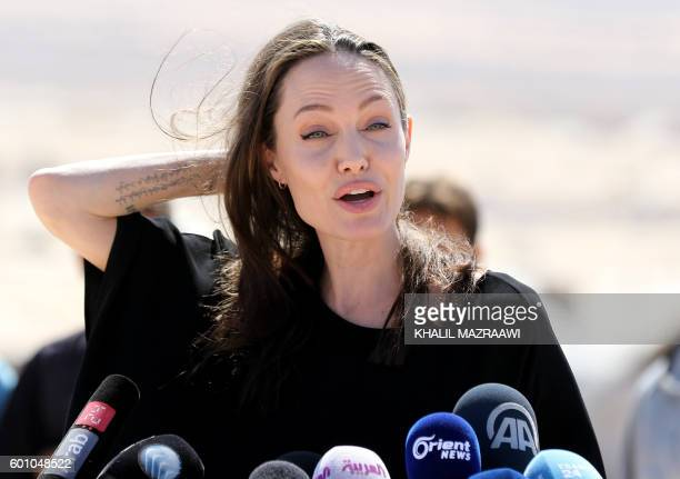 Actress and UNHCR special envoy Angelina Jolie talks during a visit to a Syrian refugee camp in Azraq in northern Jordan, on September 9, 2016.