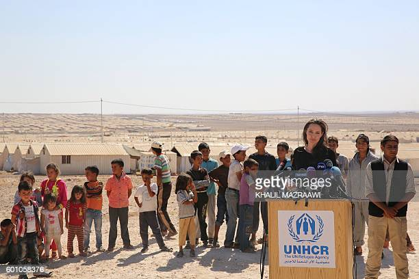 Actress and UNHCR special envoy Angelina Jolie talks to the press during a visit to a Syrian refugee camp in Azraq in northern Jordan, on September...