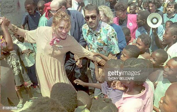 Actress and UNICEF Ambassador Julia Robert is greeted by children in the Delmas district,Port-au-Prince 11 May during her visit. Roberts is on a...